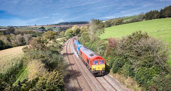 061017..66136 TnT 66025 head down into Par at Great Trevarran with 3S56 12.43 Newton Abbot(Hackney yard) to St.Blazey
