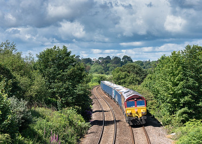 66127 passes carlyon bay GC with the  6C12  10:28 Burngullow-Exeter Riverside