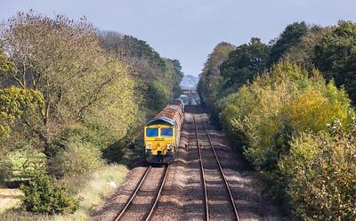 66552 TnT 66553 approach  Gunstone Mills  with the 6Y41 09:56 Westbury to Crediton
