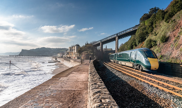 """191118  802006  heads 1A81 1100 Plymouth to London Paddington past the """"skew"""" bridge at a blustery Teignmouth"""