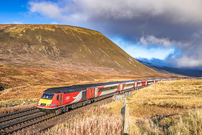 291019  .With the Boar of Badenoch as a backdrop,43367 heads the 1E13 0755 Inverness to  Kings Cross southbound