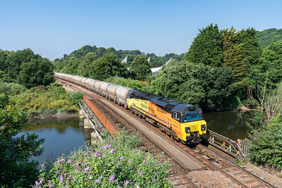 70810 heads the 6C36  08:00 Moorswater-Aberthaw cement works over the River plym near Tavistock junction