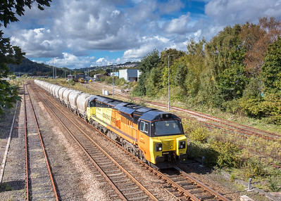 210917  With the remnants of Tavistock yard in the background 70810 thunders past with the 6C36  ThO  11:38 Moorswater-Aberthaw cement works
