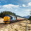 240416  37409 on the 0930 Fort William to Oban passes Lochan na Bi foot crossing