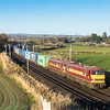 231116  One of mine...EWS pair 90028 and 90037 are right behind the cement and pass Yanwath with 4M25  06:07 Mossend-Daventry