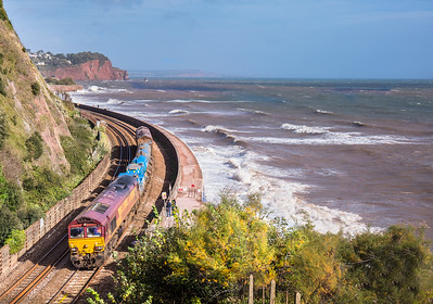 161017  With the sea wall behind them,66074  TnT 66027 head the  3J13 08:45 Westbury to St Blazey past Teignmouth.