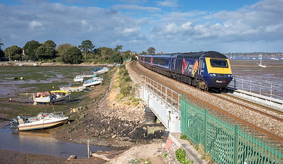 221017  FGW 125 43027 heads the 1C11 1154 Didcot Parkway to Paignton over Cockwood harbour.