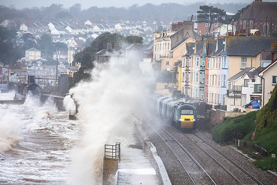 43170 heads through dawlish with the 2E63 1112 Penzance to Exeter St Davids