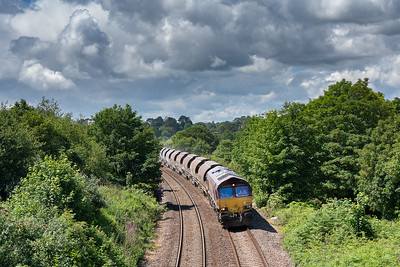 66091 heads through the reverse curves at Carlyon bay with the 6C01  12:00 Parkandillack-St.Blazey