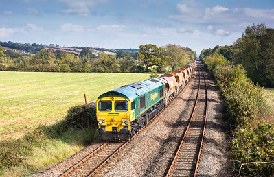 151017   66552 TnT 66553 pass Gunstone Mills  with the 6Y41 09:56 Westbury to Crediton