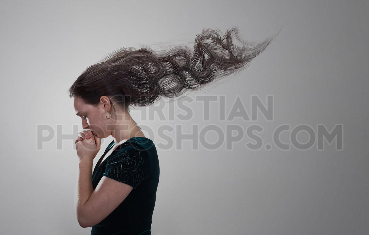 Woman praying with hair