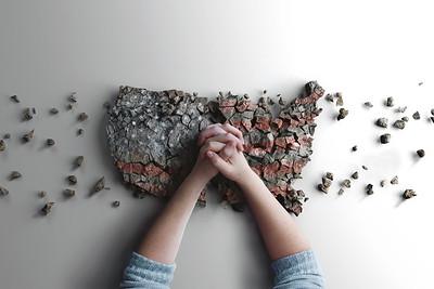Praying over broken country