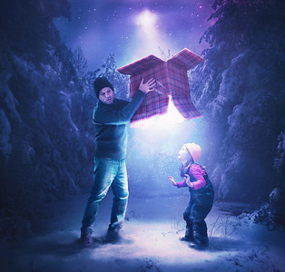 Father and child with glowing present