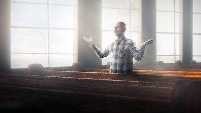 Man alone in church