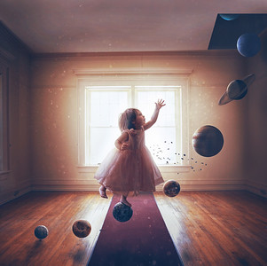 Little girl and solar system
