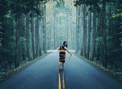 Woman wrapped up in road.