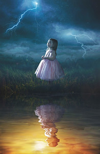 Little girl in rain storm