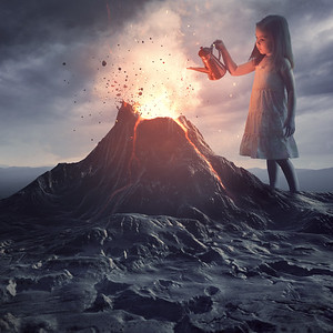Little girl putting out volcano