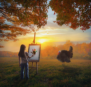 Girl Painting a turkey during fall