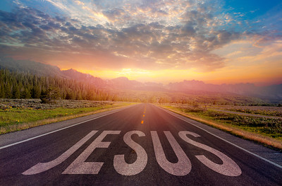 Road with Jesus sign