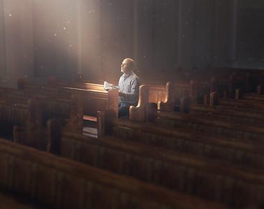 Man in church alone.