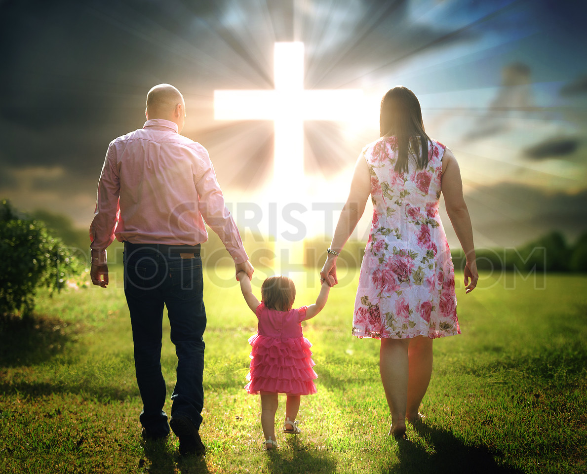 Christian family walks to cross