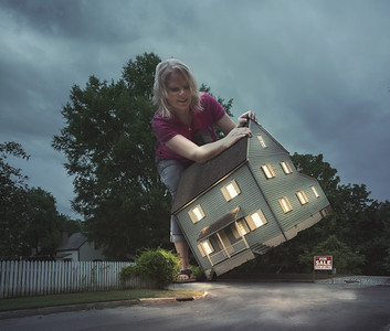 Woman picking up house