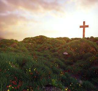 Cross on a grassy hill