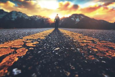 Man walking down road