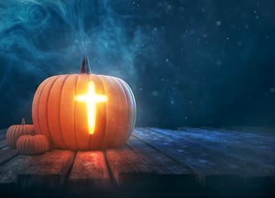 Pumpkin with glowing cross shape