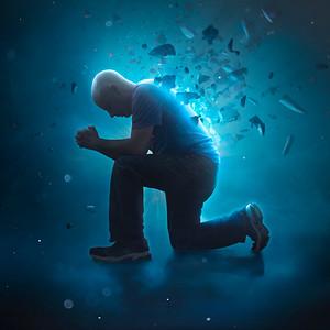 Man praying and breaking away