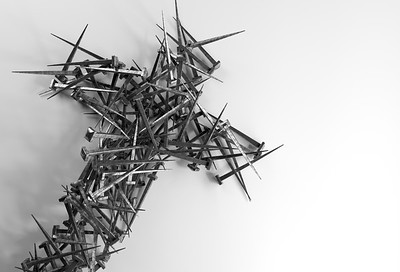 Pile of nails forming a cross shape