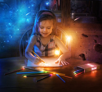 Little girl and glowing pencils