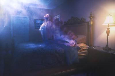Woman's Spirit ascending from bedroom