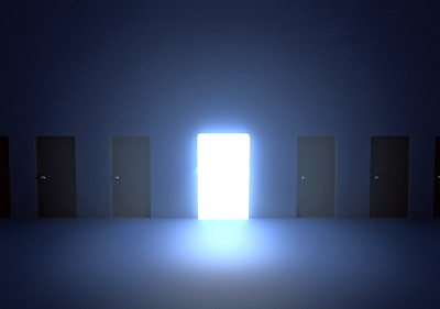A glowing door among others