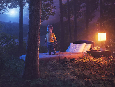 Child in bedroom in forest