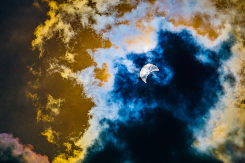 Solar Eclipse Through Clouds 1