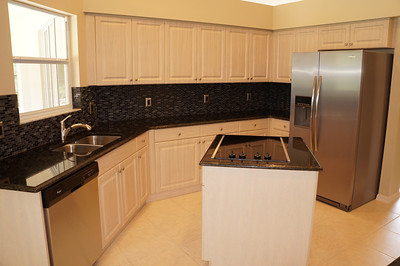 Beautiful backsplash with black granite counter tops.