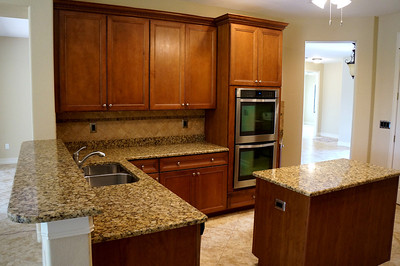 """Kitchen, featuring granite counter-tops, 43"""" cabinets, double oven"""