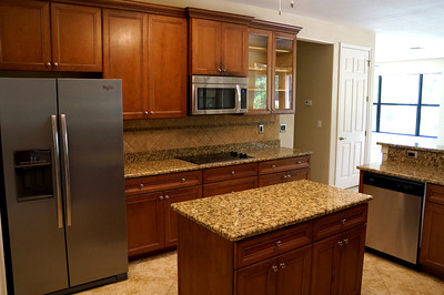 New stainless appliances and island counter with under cabinets.