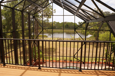 Upper sundeck overlooking the lake and pool