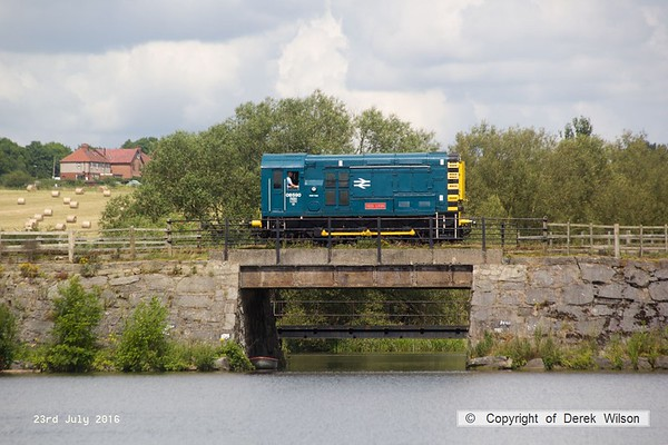 160723-047     Resident class 08 no 08590 crosses Butterley reservoir whilst on 'Driver for a fIver' duty.