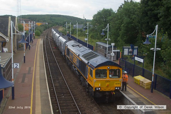 160722-022     GB Railfreight class 66/7 no 66749 waiting to leave Shirebrook as 4F88, 11.15 Shirebrook (WH Davis) to Doncaster Doncaster down decoy. The consist is Five HYA hoppers that have been modified for aggregates use..