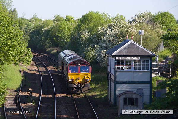 160523-002     DB Cargo class 66/0 no 66144 is captured arriving at Shirebrook hauling one Drax biomass hopper, for repair.  Seen powering 4M14, 05.23 Milford west sidings to Shirebrook, W H Davis. The branch to Davis's wagon works is to the left of the scene.