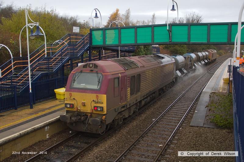 161122-006  On Tuesday 22nd November 2016 a pair of DB Cargo class 67's were captured  passing through Mansfield Woodhouse on the Robin Hood Line, powering RHTT 3J88, 21.03 Toton T.M.D. - Toton T.M.D. This is normally entrusted to DBC 66's so it was a welcome change to see 67018 Keith Heller leading and 67024 at the rear.