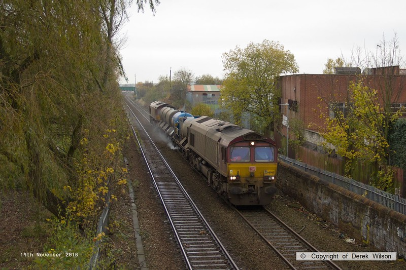 161114-001  DB Cargo class 66's no's 66065 & 66100, in top and tail mode are captured passing through Mansfield, on the Robin Hood Line, powering Rail Head Treatment Train (RHTT) 3J87, 02.20 Toton T.M.D to Toton T.M.D.