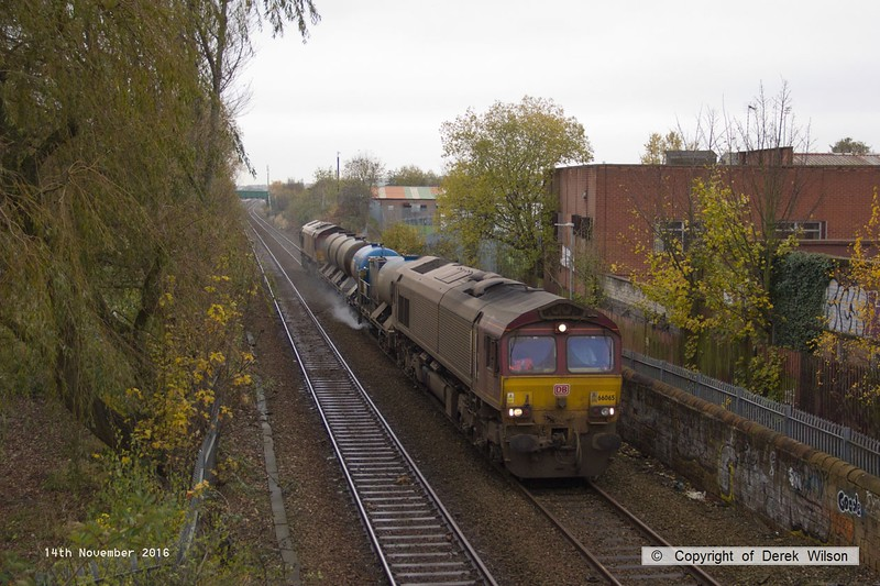161114-003  DB Cargo class 66's no's 66065 & 66100, in top and tail mode are captured passing through Mansfield, on the Robin Hood Line, powering Rail Head Treatment Train (RHTT) 3J87, 02.20 Toton T.M.D to Toton T.M.D.