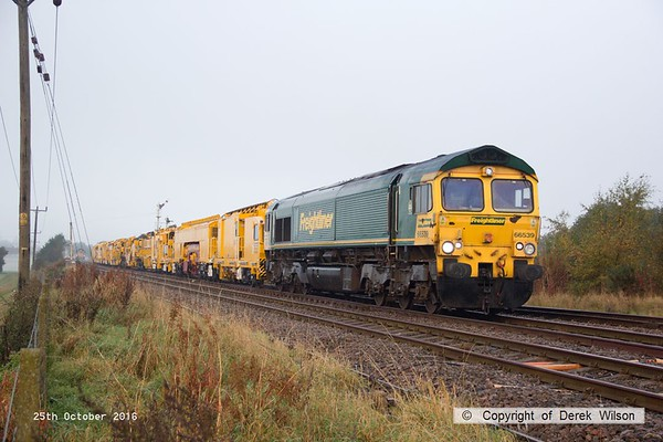 161025-016  Freightliner class 66/5 no 66539 pulls away from Thoresby with four new HOBC vehicles that are to undergo commissioning trials and staff familiarisation on the high marnham Test Track. The rest of the HOBC, fourty four MFS 'Octopus' wagons arrived on the test track on the 26th September. In the distance is 66054 which has detached from the rear of the consist.