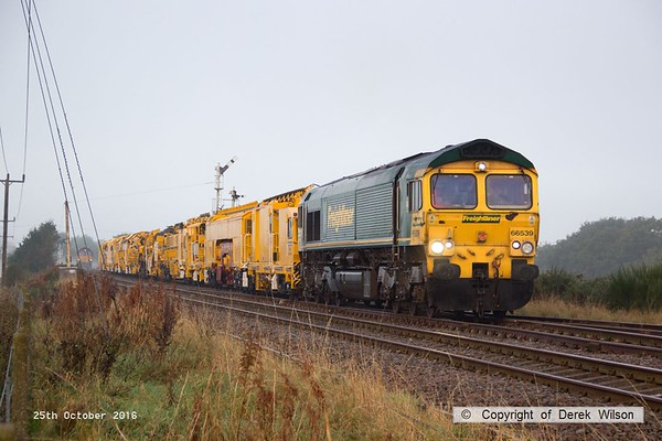 161025-014  Freightliner class 66/5 no 66539 pulls away from Thoresby with four new HOBC vehicles that are to undergo commissioning trials and staff familiarisation on the high marnham Test Track. The rest of the HOBC, fourty four MFS 'Octopus' wagons arrived on the test track on the 26th September. In the distance is 66054 which has detached from the rear of the consist.
