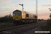 161017-005  With the sun just rising Freightliner class 66/5 no 66585 The Drax Flyer passes the former Clipstone junctions, running light as 0Y37, 06.26 Doncaster up decoy to Thoresby colliery junction. This was heading onto the High Marnham Test Track as standby loco for the new HOBC system that is currently undergoing commissioning trials & staff familiarisation.